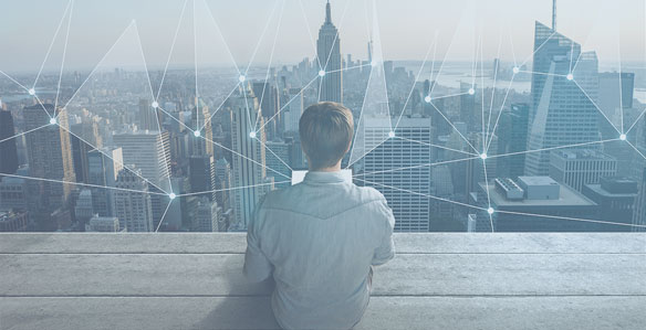 person overlooking the city skyline image